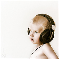A baby wearing headphone, ain