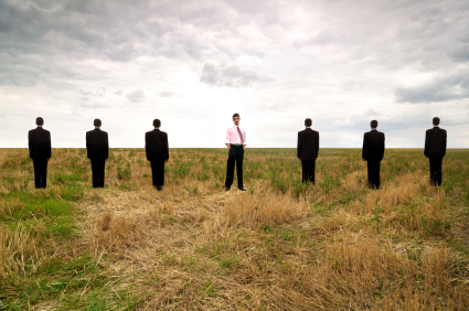Standing businessman in a line of seven
