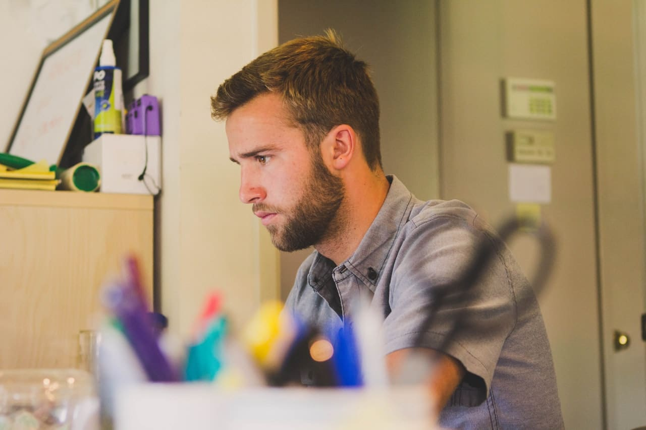 man focusing on work